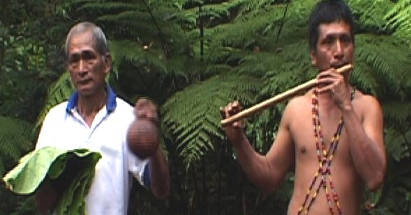Felipe Wampash performs with another Shuar musician